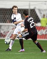 Santino Quaranta #25 of D.C. United blocks Seth Sinovic #27 of the New England Revolution during an MLS match on April 3 2010, at RFK Stadium in Washington D.C.