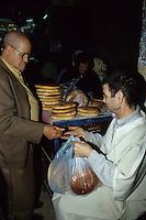 Fez, Morocco - A Baker Selling Bread.