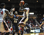"Ole Miss' Murphy Holloway (31) vs. East Tennessee State's Hunter Harris (20) at the C.M. ""Tad"" Smith Coliseum in Oxford, Miss. on Saturday, December 14, 2012. Mississippi won 77-55 to improve to 7-1. (AP Photo/Oxford Eagle, Bruce Newman).."