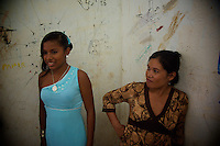A school beauty pageant participant with her mother - Puerto Narino - Amazonas - Colombia