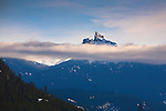 The peak of Black Tusk Mountain rises above a layer of clouds near Whistler, B.C. in western Canada