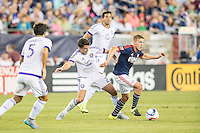 Foxborough, Massachusetts - September 5, 2015:  The New England Revolution (blue and red) beat Orlando City (white and purple) 3-0 in a Major League Soccer (MLS) match at Gillette Stadium.