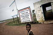 A child is seen outside the Posco India transit camp in Badagabapur, in Jagatsinghpur, Orissa. Posco Transit Camp is being set up for people who have been driven out of their villages for being pro-Posco, where they live on the side of a highway on $80 a day shared between 195 people.
