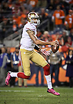 SHOT 10/19/14 8:16:14 PM - San Francisco 49ers quarterback Colin Kaepernick #7 takes off on a run with the ball against the Denver Broncos at Sports Authority Field at Mile High Sunday October 19, 2014 in Denver, Co. The Broncos beat the 49ers 42-17.<br /> (Photo by Marc Piscotty / &copy; 2014)
