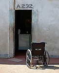 Caroline Mandishona's wheelchair sits outside the door of her home in Bulawayo, Zimbabwe. Mandishona suffered cerebral palsy and uses a wheelchair provided by the Jairos Jiri Association with support from CBM-US.