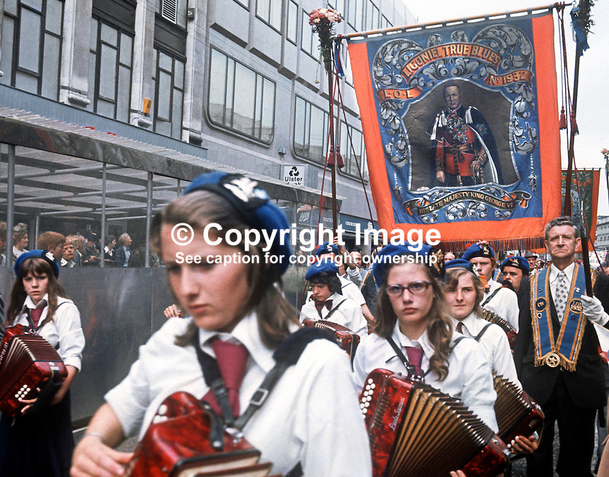 Twelfth procession passing the city centre, Belfast, N Ireland, on its way to The Field. 197607120331b<br /> <br /> Copyright Image from Victor Patterson, 54 Dorchester Park, Belfast, UK, BT9 6RJ<br /> <br /> Tel: +44 28 9066 1296<br /> Mob: +44 7802 353836<br /> Voicemail +44 20 8816 7153<br /> Email: victorpatterson@me.com<br /> Email: victorpatterson@gmail.com<br /> <br /> IMPORTANT: My Terms and Conditions of Business are at www.victorpatterson.com