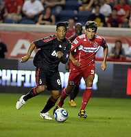 AC Milan midfielder Ronaldinho (80) dribbles away from Chicago Fire midfielder Baggio Husidic (9).  AC Milan defeated the Chicago Fire 1-0 at Toyota Park in Bridgeview, IL on May 30, 2010.