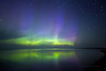 Summer aurora reflections over Lake Superior