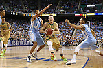 14 March 2015: Notre Dame's Pat Connaughton (center) is defended by North Carolina's Brice Johnson (11) and J.P. Tokoto (13). The Notre Dame Fighting Irish played the University of North Carolina Tar Heels in an NCAA Division I Men's basketball game at the Greensboro Coliseum in Greensboro, North Carolina in the ACC Men's Basketball Tournament quarterfinal game. Notre Dame won the game 90-82.
