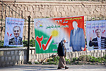 KIRKUK, IRAQ; a Kirkuk citizen pass by the electoral posters of Kurdistan Alliance List,  on February 12th,2010 the first day of Electoral campaigns...Election workers start their campaigns for the Iraqi Parliamentary Elections due to be held March 7th, 2010....Photo by Hawre Khalid/ Metrography