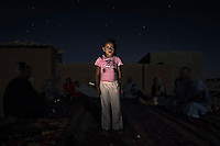 Chrifa Mohammed Salem, 6. Pictured outside her home in Auserd refugee camp, Algeria: 'I go to school and then I come back and play with my sister. It is very hot, I want it to be cold. I want to be a teacher when I grow up. There is no water here.'