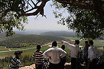 Ultra-Orthodox Jewish men and kids tour a site overlooking Elah Valley.