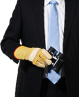 Manager holding binoculars to look after opportunities or dangerous situations