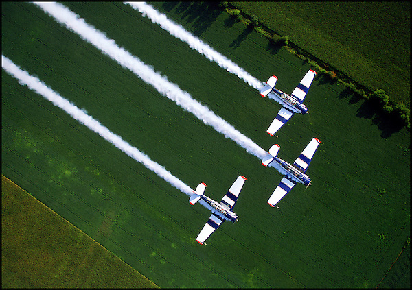 The Aeroshell Aerobatic Team, formerly known as the North American Aerobatic Team flies three T-6 Texan trainers in formation near Goshen, IN.