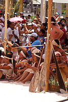 Canoeists and spectators at the closing ceremonies at Playa del Carmen or Xamanha during the Sacred Mayan Journey 2011 event, Riviera Maya, Quintana Roo, Mexico.