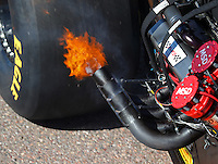 Feb 25, 2017; Chandler, AZ, USA; Detailed view as fire comes from the exhaust header pipes on the dragster of NHRA top fuel driver Clay Millican during qualifying for the Arizona Nationals at Wild Horse Pass Motorsports Park. Mandatory Credit: Mark J. Rebilas-USA TODAY Sports
