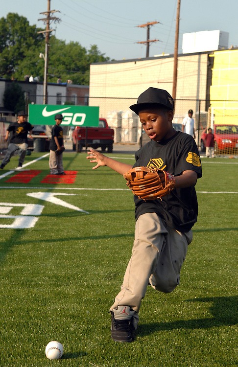 Joshua Kelly, 7, fields a ball during teeball practice at the Boys and Girls Club of Washington, in Anacostia.