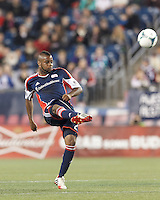 New England Revolution defender Andrew Farrell (2) volleys ball back into play. In a Major League Soccer (MLS) match, the New England Revolution (blue) defeated Columbus Crew (white), 3-2, at Gillette Stadium on October 19, 2013.