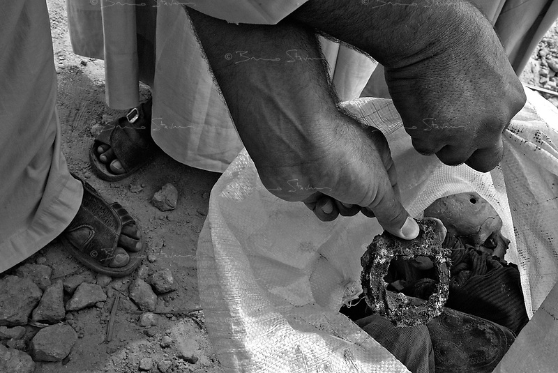 """Hamadiyah, Iraq, May 26, 2003.Several mass graves containing bodies of thousands of Kurds captured and deported in 1988 during """"operation Amfal"""" are beginning to be discovered in the desert between Kerbala and Nedjaf, they all contain civilians, including some women and children. .Unfortunately, the diggings are often executed without proper methodology which leads to the destruction of evidence against the perpetrators but perhaps more crucialy prevents accurate identifications of the remains."""