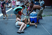 New York, USA. 28 June 2014. Woman fall down while they take part in the gay pride parade 2014 in New York. Photo by Eduardo MunozAlvarez/VIEWpress