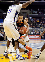 Jared Cunningham tries to dribble in against Matthew Bryan-Amaning. The Washington Huskies defeated the Oregon State Beavers 59-52 during the Pac-10 Tournament at the Staples Center in Los Angeles, California on March 11th, 2010.