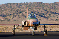 A U.S. Navy F-5 Aggressor from VFC-13 based out of NAS Fallon sits on the tarmac at Stead Field, Nevada. Although the Northrup built F-5 does not serve as a front line fighter the aircraft was adopted for use as a opposing forces (OPFOR) role because of its small size and performance similar to the Soviet built Mig-21. Photographed 09/07