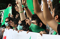 Protesters in Haftetir Square wearing green, the colour of the opposition, and masks as a symbol of their silent protest. Following a disputed election result, thousands of supporters of opposition candidate Mir-Hossein Mousavi took to the streets in protest.
