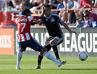 Santa Clara, California - Sunday May 13th, 2012: Miller Bolanos of Chivas USA clashes with Rafael Baca of  San Jose Earthquakes during a Major League Soccer match at Buck Shaw Stadium