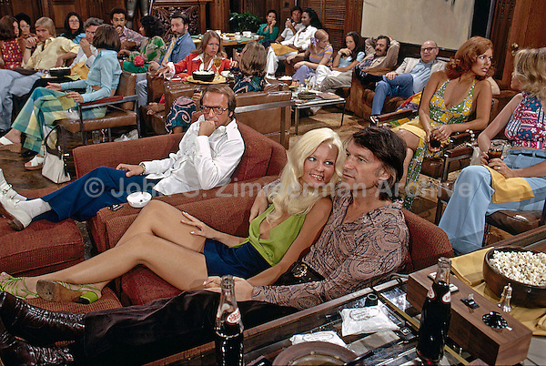 Hugh Hefner with Karen Christy at his Chicago mansion, 1973. Photo by John G. Zimmerman.