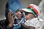 Hadiya Sadik and her son, Sudanese migrants living in Misrata, the besieged Libyan city where civilians and rebel forces are surrounded on three sides by forces loyal to Libyan leader Moammar Gadhafi, make contact with family at home using a satellite phone provided by the Libyan Red Crescent.