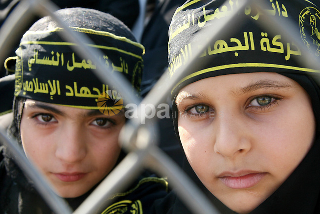 Palestinian supporters of the Islamic Jihad military wing Saraya Al-Quds or 'Jerusalem Brigades' rally during a gathering to mark the anniversary of the assassination of the founder of their movement Fathi Shiqaqi in Khan Yunis in the southern Gaza Strip. Shiqaqi was assassinated in Malta on 26 October 1995 allegedly by Mossad by Israel agents.