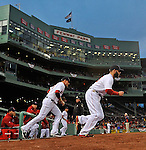 (Boston, MA, 04/11/13) Members of the Boston Red Sox take the field against the Baltimore Orioles at Fenway Park on Thursday, April 11, 2013. Staff photo by Christopher Evans