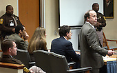 Defense attorney Peter Greenspun, right, address the court as sniper suspect John Allen Muhammad, seated left, listens as they respond to a jury question in the trial of sniper suspect John Allen Muhammad in courtroom 10 at the Virginia Beach Circuit Court in Virginia Beach, Virginia on November 14, 2003. <br /> Credit: Davis Turner - Pool via CNP