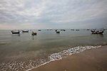 Fishing boats float in the flat sea off Mui Ne, Vietnam. Nov. 20, 2011.