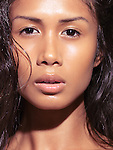 Closeup natural sensual beauty portrait of a young woman looking at camera