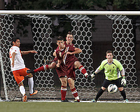 Corner kick action. Boston College defender Chris Ager (2) works to clear ball. Boston College defender Nick Corliss (5) and Boston College goalkeeper Alex Kapp (1)Boston College (maroon) defeated Syracuse University (white/orange), 3-2, at Newton Campus Field, on October 8, 2013.
