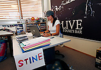 Marketing director for Roxy,  Stine Brun Kjeldaas, is a former snowboard professional and Olympic silver medalist. Here she is seen working at her desk in the Roxy Europe headquarters in Saint Jean de Luz. Near Biarritz, France.