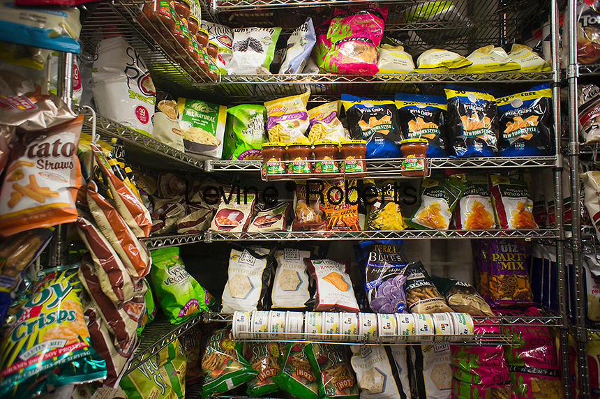 A display of tasty snacks are seen in a supermarket in New York on Friday,September 14, 2012. A recent study states that potato chips are the biggest source of obesity  with Americans putting on a pound a year.  (© Richard B. Levine)
