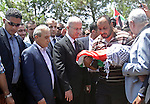 Palestinian Prime Minister looks at the body of 18-month-old Palestinian baby Ali Dawabsheh, who was killed after his family's house was set on fire in a suspected attack by Jewish extremists in Duma village near the West Bank city of Nablus July 31, 2015. Suspected Jewish attackers torched a Palestinian home in the occupied West Bank on Friday, killing an 18-month-old toddler and seriously injuring three other family members, an act that Israel's prime minister described as terrorism. Photo by Prime Minister Office