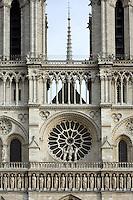 Rose window and spire, West façade, Notre Dame de Paris, 1163 ? 1345, initiated by the bishop Maurice de Sully, Ile de la Cité, Paris, France. Picture by Manuel Cohen