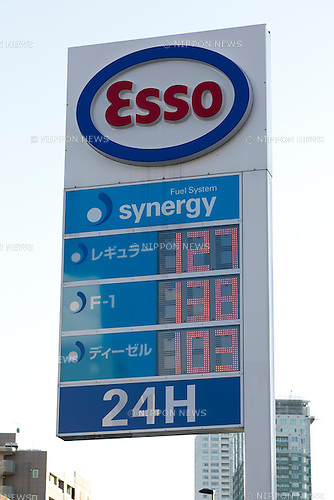 Esso electric board on display at its gas station in Tokyo, Japan on December 4, 2015. Japan's largest oil refiner and wholesaler JX Holdings Inc., which operates ENEOS gas stations, is continuing talks to finalize the acquisition of competitor TonenGeneral Sekiyu by the end of this year. The companies have combined sales of 14 trillion yen ($113 billion) and plan a share swap in the latest move towards consolidating their businesses by 2017. JX Holdings operates 14,000 ENEOS gas stations and TonenGeneral operates Esso, Mobil and General brand gas stations. Together they represent around 40% of all stations in Japan. (Photo by Rodrigo Reyes Marin/AFLO)