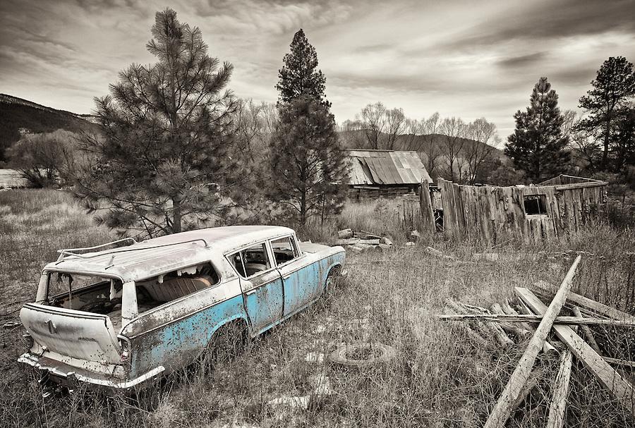 A teal Rambler cross country station wagon sits at an abandoned homestead near Blanchard, Idaho