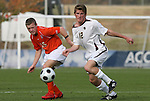 12 November 2008: Boston College's Stephen Hepburn (12) and Clemson's Nick Burton (15). Boston College defeated Clemson University 1-0 in the second sudden-victory overtime period at Koka Booth Stadium at WakeMed Soccer Park in Cary, NC in a men's ACC tournament quarterfinal game.
