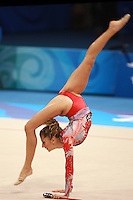 August 22, 2008; Beijing, China; Rhythmic gymnast Eleni Andriola of Greece performs reverse walkover (L-R) with clubs on way to placing 21st in qualifying round at 2008 Beijing Olympics. Copyright 2008 Tom Theobald