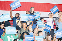 People wait for the arrival of Democratic presidential nominee Hillary Clinton before her speech at a campaign rally in the Theodore R. Gibson Health Center at Miami Dade College-Kendall Campus in Miami, Florida, USA. Former Vice President Al Gore also spoke at the rally.