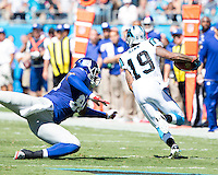 The Carolina Panthers played the New York Giants at Bank of America Stadium in Charlotte, NC.  The Panthers won 38-0 for their first victory of the season.  The Giants dropped to 0-3.  New York Giants tight end Larry Donnell (84), Carolina Panthers wide receiver Ted Ginn (19)
