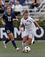 Harvard University midfielder Meg Casscells-Hamby (3) brings the ball forward. In overtime, Harvard University defeated Yale University,1-0, at Soldiers Field Soccer Stadium, on September 29, 2012.