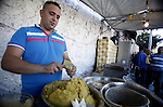 "A Palestinian displays dishes of traditional known as ""Falafel"" in the old city of Jerusalem during the fasting month of Ramadan on July 31, 2012. Photo by Saeed Qaq"