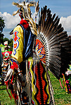 Close up of Fancy dancers bustle regalia, Thunderbird Powwow at the Queens County Farm Museum.<br /> <br /> The Native American bustle is a traditional part of a man's regalia worn during a dance exhibition or pow wow and originates from the Plains region of the United States. The men's bustle is typically made of a string of eagle or hawk feathers attached to a backboard. Eagle and hawk feathers are sacred religious objects to Native American people.<br /> <br /> The traditional bustle or &quot;old-style&quot; bustle, being circular.  Fancy dancers generally wear two bustles, one attached to a belt above the buttocks and another attached to a harness on the back.