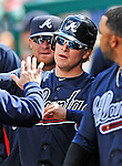 2 April 2011: Atlanta Braves outfielder Nate McLouth returns to the dugout after scoring against the Washington Nationals at Nationals Park in Washington, District of Columbia. The Nationals defeated the Braves 6-3 in the second game of their season opening series. Mandatory Credit: Ed Wolfstein Photo